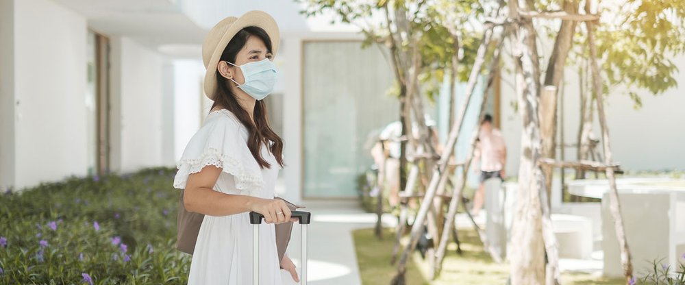 happy-tourist-woman-wearing-surgical-face-mask.jpg